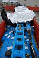 Reverse Circulation / Core Drilling Rig is being prepared for ocean freight in a 40' Open Top container.Desiccant product is used for humidity control, with a vapor-barrier bag protecting the rig.